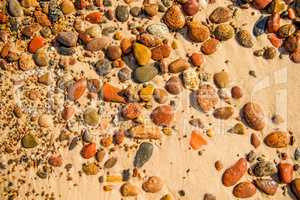 pebbles stones on a sandy beach