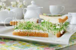 Sandwich with ricotta and alfalfa sprouts