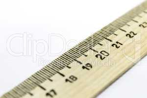 drawing ruler diagonally over white background
