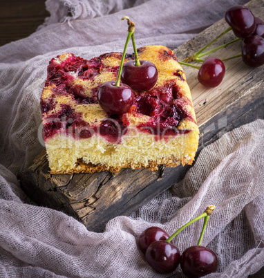 piece of biscuit baked cake with cherry