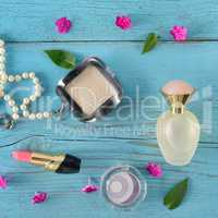 Set of decorative cosmetics on wooden table. Flat lay, top view.
