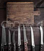 used kitchen knives and  cutting board
