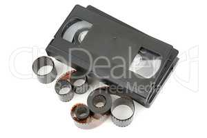 A set of video tapes and photographic film isolated on white bac