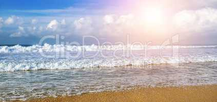 Seascape and sun on blue sky background. Wide photo.