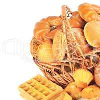 Bread and baked goods in a wicker basket isolated on a white bac