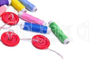 Sewing thread and buttons isolated on white background. Free spa