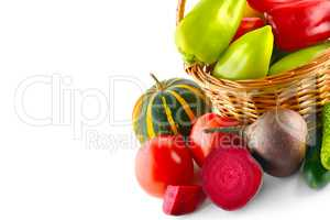 Set of vegetables in wicker basket isolated on white. Free space