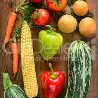 Vegetables laid out on a wooden table.