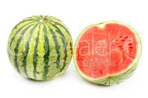 Ripe round watermelon and half berry isolated on white backgroun