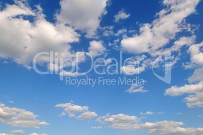cumulus clouds in the blue sky. A bright sunny day
