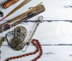 stone rosary and incense sticks