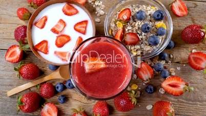 Healthy breakfast with strawberry smoothie and yogurt
