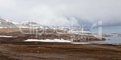 Mountain landscape and satellite dish in Ny Alesund, Svalbard is