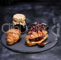 baked croissants with strawberry jam
