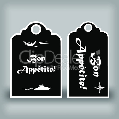 "Two black labels ""Bon appetit"""