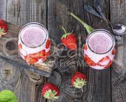 yoghurt with fresh strawberries in a glass jar