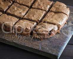 sliced square pieces of chocolate cake