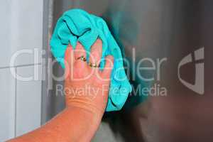 Housework wipe off dust and dirt with blue rags.
