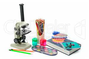 Laboratory microscope, textbook and other school supplies isolat