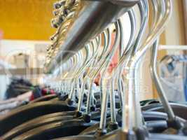Many hangers on a clothes rack
