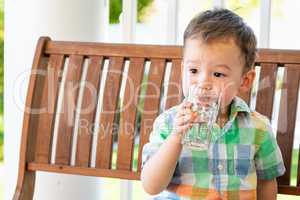 Mixed Race Chinese and Caucasian Boy Enjoying A Glass Of Water