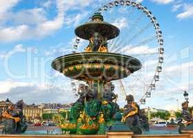 Fountain and ferris wheel in Paris