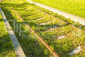 railway overgrown with green grass