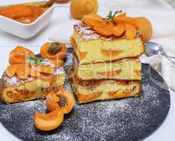 square pieces of apricot pie on a black graphite plate