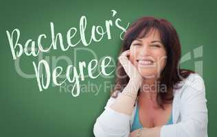 Bachelor's Degree Written On Green Chalkboard Behind Smiling Mid