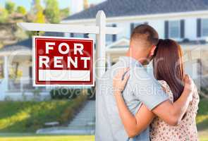Military Couple Looking At House with For Rent Real Estate Sign