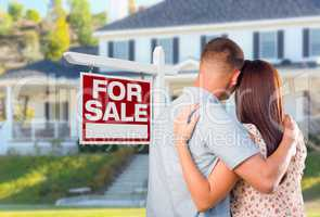 Military Couple Looking At House with For Sale Real Estate Sign