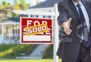Male Agent Reaching for Hand Shake in Front of Sold For Sale Sig