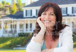 Attractive Middle Aged Woman Relaxing In Front Yard of Beautiful