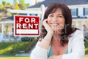 Middle Aged Woman In Front of House with For Rent Real Estate Si