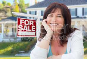 Middle Aged Woman In Front of House with For Sale Real Estate Si