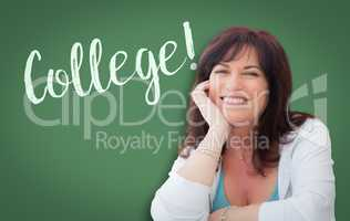 College Written On Green Chalkboard Behind Smiling Middle Aged W