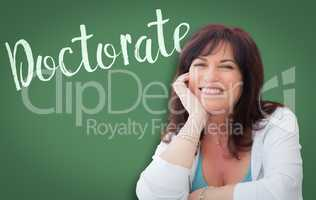 Doctorate Written On Green Chalkboard Behind Smiling Middle Aged