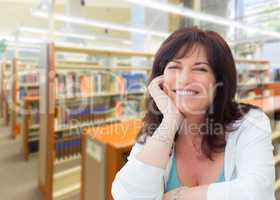 Smiling Middle Aged Woman Inside The Library