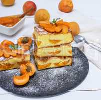 baked pieces of biscuit pie with apricots