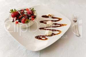 Dessert with strawberries and yogurt in a bowl