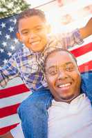 African American Father and Mixed Race Son Piggy Back with Ameri