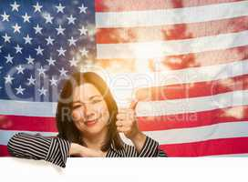 Hispanic Woman With Thumbs Up In Front of American Flag