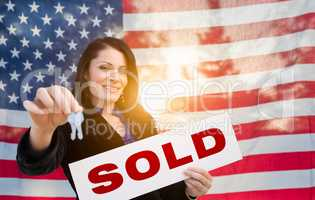 Hispanic Woman House Keys and Sold Sign In Front of American Fla