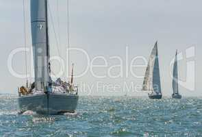 Sail Boats or Yachts Sailing on A Beautiful Sunny Day