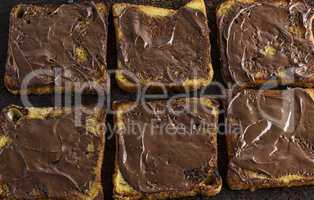 square pieces of fried white bread smeared with chocolate