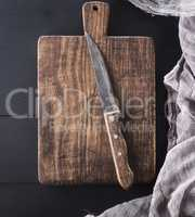 cutting board with handle and kitchen knife