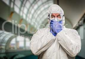 Man Covering Mouth With Hands Wearing HAZMAT Protective Clothing