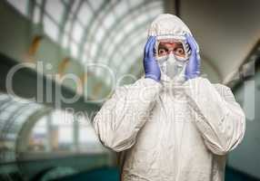 Man Holding Head With Hands Wearing HAZMAT Protective Clothing I