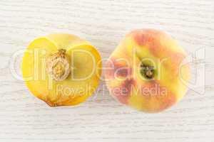 Fresh Raw yellow peach on grey wood