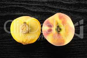 Fresh Raw yellow peach on black wood